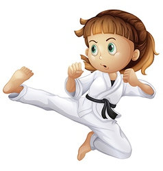 A brave young girl doing karate vector