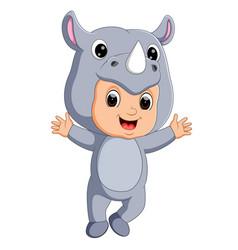 cute boy cartoon wearing rhinoceros costume vector image vector image