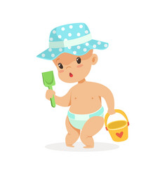 Cute baby in a diaper playing with toy bucket and vector