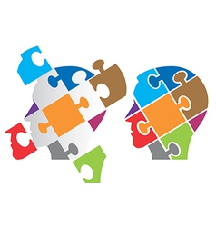 Puzzle heads symbolizing psychology vector