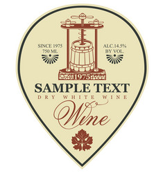 Label for wine with a wine press and barrel vector