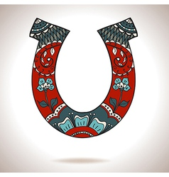 Horseshoe with floral ornament vector
