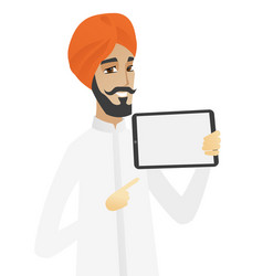 Hindu businessman holding tablet computer vector
