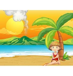 A girl holding a book at the seashore vector image