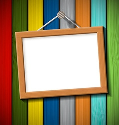 Wooden frame on a colored wall vector
