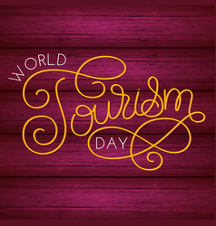World tourism day hand lettering on wood vector