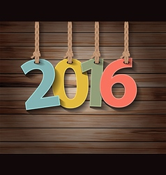 Happy new year 2016 paper greeting card on wood vector image