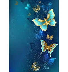 Golden Butterflies on a Blue Background vector image