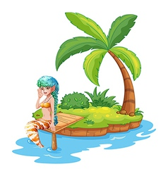 A pretty mermaid in the island vector image