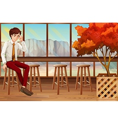 Man sitting in the restaurant vector