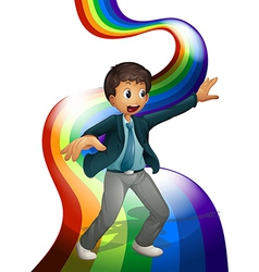 A boy dancing above the rainbow vector image