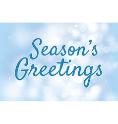 Seasons greetings with blue bokeh background vector