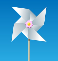 Paper pinwheel isolated on blue background vector