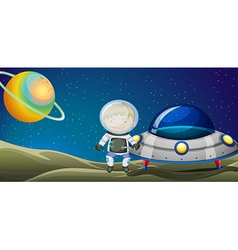 A young explorer beside the spaceship vector image