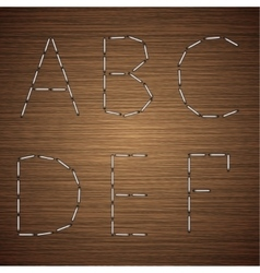 Modern staples alphabet on wooden vector