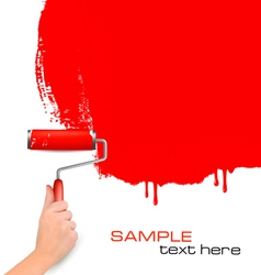 Hand with red roller painting vector
