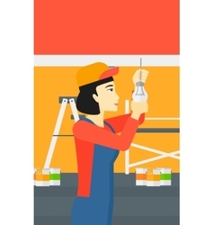 Electrician twisting light bulb vector