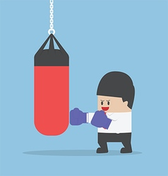 Businessman wearing boxing gloves and punch the pu vector image