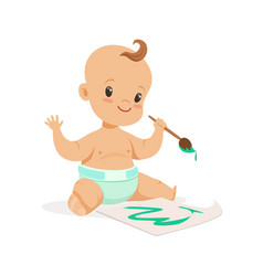 Happy baby in a diaper painting with paintbrush vector