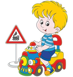 Boy on a toy train vector