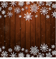 christmas snowflakes on wood background vector image