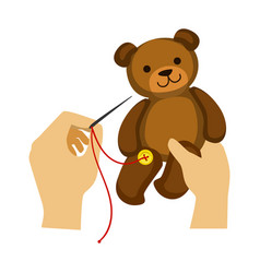two hands stitching button to a teddy bear toy vector image vector image