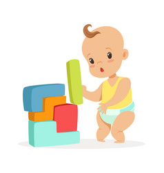 Cute baby standing and playing with toy blocks vector