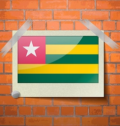Flags togo scotch taped to a red brick wall vector
