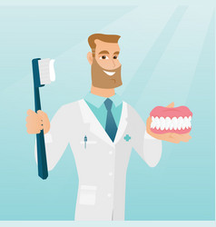 Dentist with a dental jaw model and a toothbrush vector
