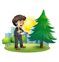 A man using his gadget outside the building vector image