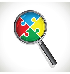 Magnifying glass on a multicoloured jigsaw vector