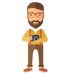 Photographer holding his camera vector