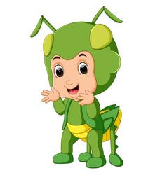 cute boy cartoon wearing grasshopper costume vector image vector image