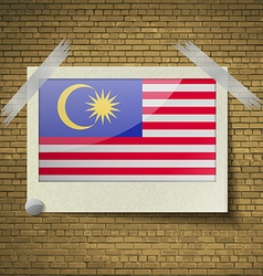 Flags malaysia at frame on a brick background vector