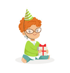 Adorable baby boy wearing a green party hat vector