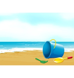 A bucket fork and shovel at the beach vector