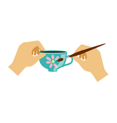 two hands painting a teacup elementary school art vector image vector image