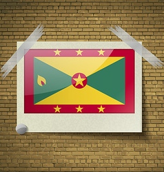 Flags grenada at frame on a brick background vector