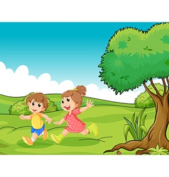 Two adorable little kids playing at the hilltop vector image