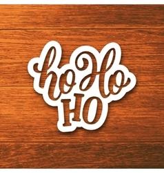 Ho-ho-ho lettering on paper label vector