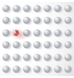 Red cube among white spheres standing out in the vector