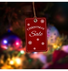 Christmas sales tag Label on a blurred background vector image