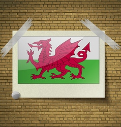 Flags Walesat frame on a brick background vector image