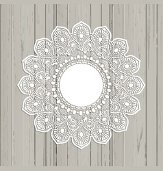 Lace style mandala on a wooden background vector