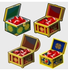 Four chests different colors with rubies vector