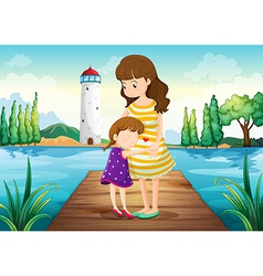 A young girl hugging her mother at the bridge vector image