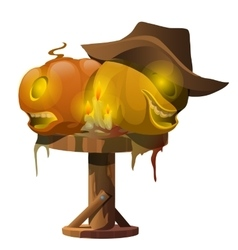 Carved pumpkins candles and cowboy hat on table vector