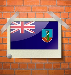 Flags montserrat scotch taped to a red brick wall vector