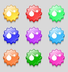 Bomb icon sign symbol on nine wavy colourful vector