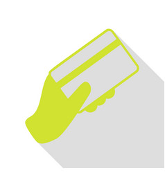 Hand holding a credit card pear icon with flat vector